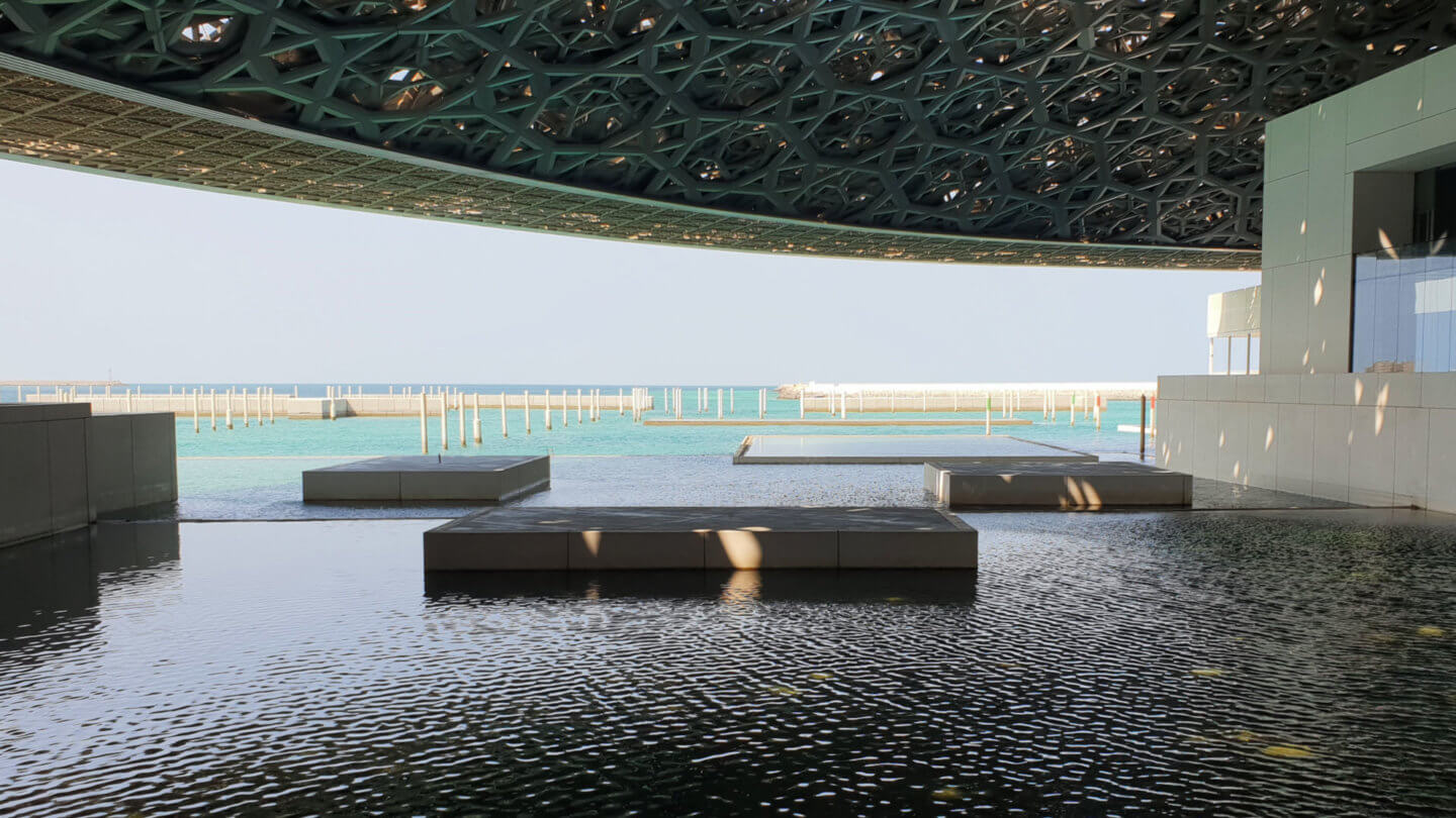 Terrace view from inside the Louvre Abu Dhabi, out to the Arabian Gulf